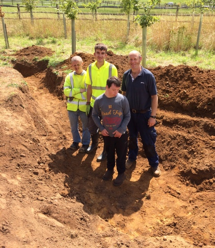 The Growth Team from Surrey Choices and Andy in the new pond that we have been digging.