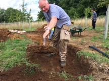 Richard digging a ditch to the new pond.
