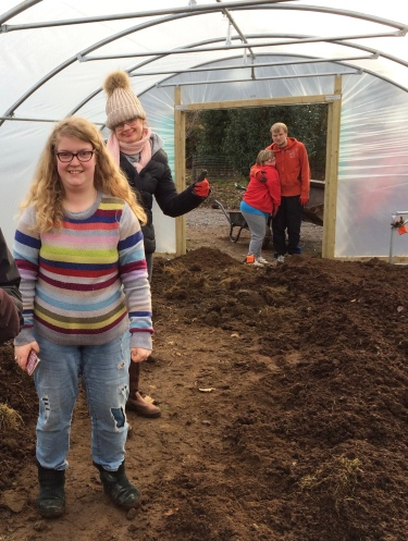 Thanks to the Halow volunteers who helped to bring in soil to level the new polytunnel