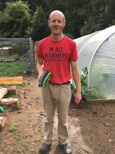 Andy and the first courgettes from the garden