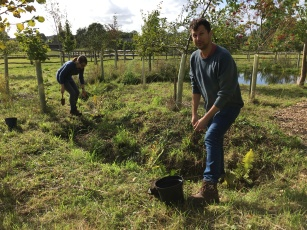 Caroline and Ben working on the woodland ditch planting